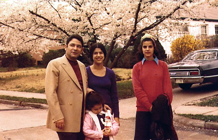 Israeli military attache Joseph Alon poses with daughters Rachel (foreground), Yael (center) and Dalia outside their home in Chevy Chase, Md., in 1973, the year he mysteriously was shot to death in his driveway. (AP Photo/Courtesy of the Alon family)