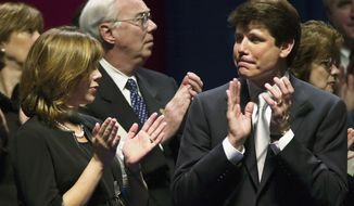 ** FILE ** In this Jan. 13, 2003, file photo, Illinois' first lady Patti Blagojevich, left, applauds with her father, Richard Mell, center, during inauguration day ceremonies for her husband, Gov. Rod Blagojevich, in Springfield, Ill. Blagojevich, convicted on 18 counts of corruption in June 2011, is scheduled to appear in federal court in Chicago, Tuesday, Dec. 6, 2011, for the start of his sentencing hearing. (AP Photo/Charles Rex Arbogast, File)