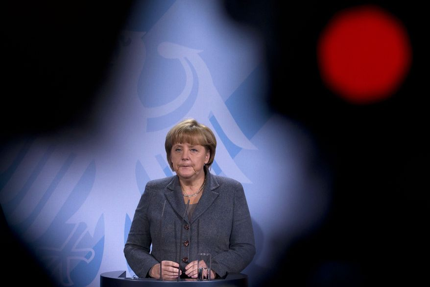 German Chancellor Angela Merkel responds to questions at a press conference at the Chancellery in Berlin on Tuesday, Dec. 6, 2011, about the possibility that Standard & Poor's may downgrade the credit ratings of 15 eurozone countries, including Germany's. (AP Photo/Markus Schreiber)