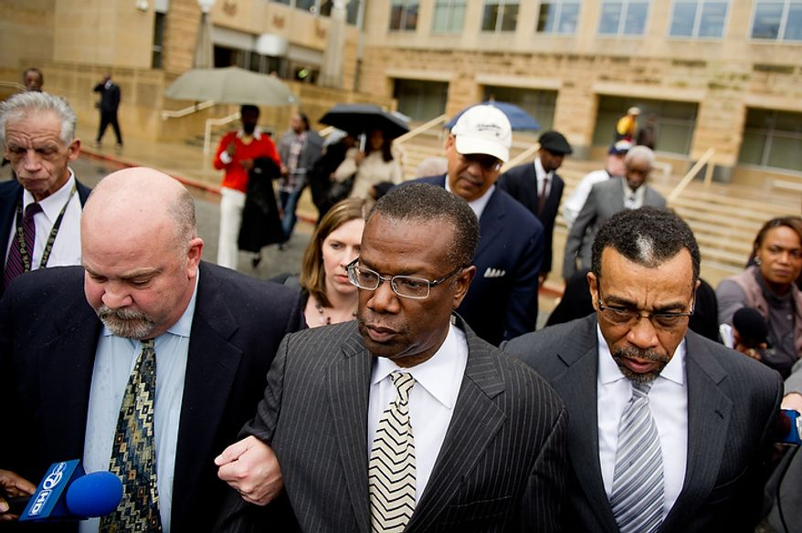 **FILE** Former Prince George's County Executive Jack Johnson walks out of the U.S. District Courthouse in Greenbelt, Md. (Andrew Harnik/The Washington Times)