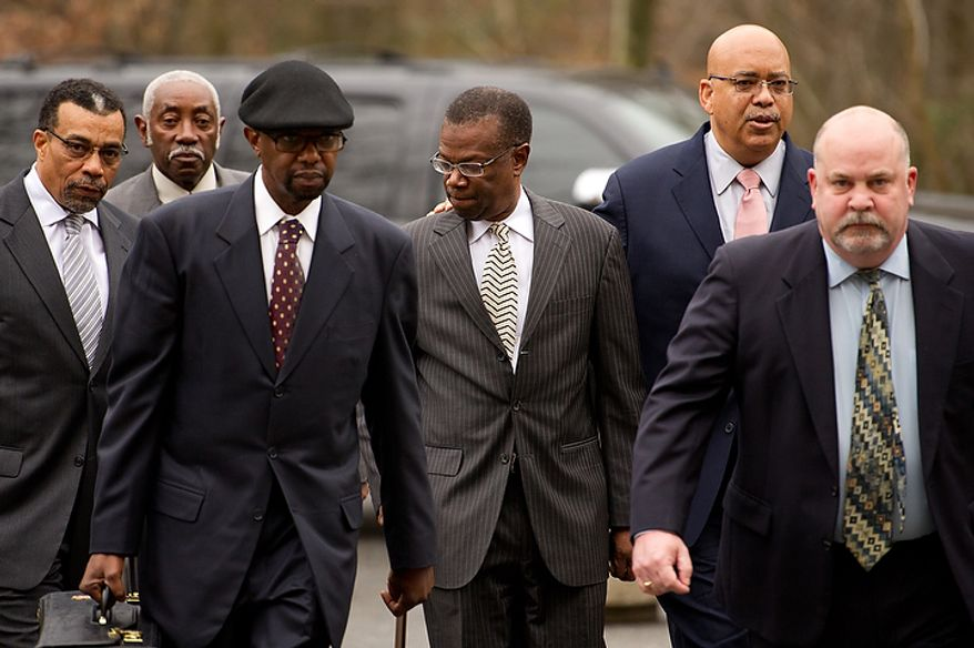 Former Prince George's County Executive Jack Johnson walks into the U.S. District Courthouse in Greenbelt, Md., on Dec. 6, 2011, for his sentencing after being found guilty for corruption in a pay-to-play scandal. Also pictured is his lawyer Billy Martin, left. (Andrew Harnik/The Washington Times)