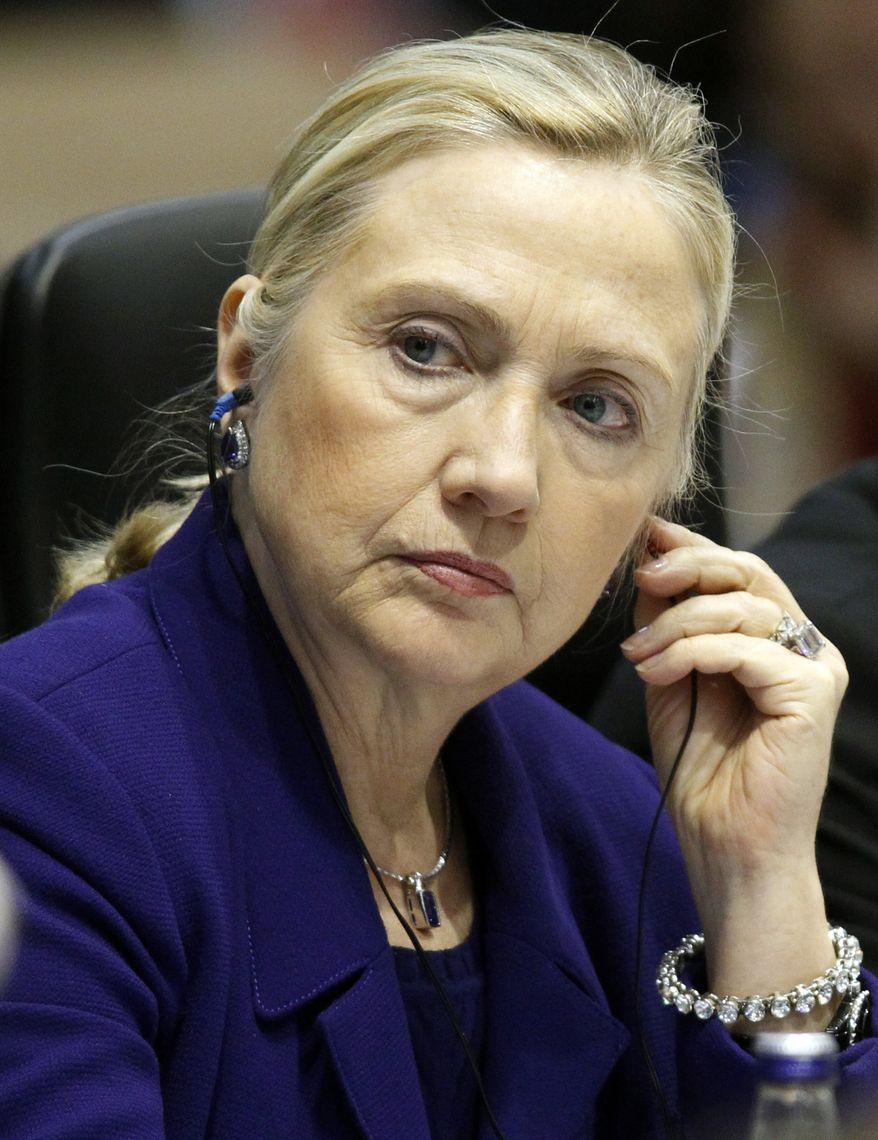 Secretary of State Hillary Rodham Clinton attends a meeting of the Organization for Security and Cooperation in Europe in Vilnius, Lithuania, on Tuesday, Dec. 6, 2011. (AP Photo/Mindaugas Kulbis)