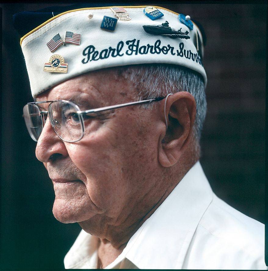"Jay Groff, 89, served in the Army Air Corps Rescue Boat Service at Pearl Harbor, Oahu. Groff was in bed as the Japanese attack on Pearl Harbor began, which he says probably saved his life. Groff calls the attack the most important day of the 20th century, adding that ""the world changed for the United States."" He goes on to say, ""I grew up overnight.... That morning, I realized that there was somebody out there trying to kill me. That changed my outlook on life."" Groff is seen at his home in Springfield, Va. on Nov. 21, 2011. (T.J. Kirkpatrick/ The Washington Times)"