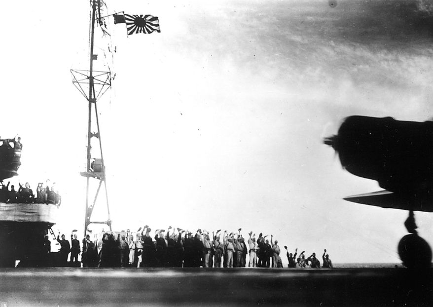 """This photograph, from a Japanese film later captured by American forces, is taken aboard the Japanese aircraft carrier Zuikaku, just as a Nakajima """"Kate"""" B-5N bomber is launching off deck for the second wave of the attack on Pearl Harbor, Hawaii, on December 7, 1941. (AP Photo)"""