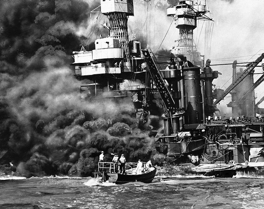 """In this Dec. 7, 1941 file photo provided by the U.S. Navy, a Navy launch pulls up to the blazing USS West Virginia to rescue a sailor during the attack on Pearl Harbor. An excavation crew recently made a startling discovery at the bottom of Pearl Harbor when it unearthed a skull that archeologists suspect is from a Japanese pilot who died in the historic attack. Archaeologist Jeff Fong of the Naval Facilities Engineering Command Pacific described the discovery to The Associated Press and the efforts under way to identify the skull. He said the early analysis has made him """"75 percent sure"""" that the skull belongs to a Japanese pilot.  (AP Photo/U.S. Navy, file)"""