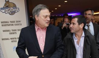 Florida Marlins owner Jeffrey Loria, left, and team president David Samson chat as they walk through the lobby of the hotel hosting Major League Baseball's winter meetings in Dallas, Tuesday, Dec. 6, 2011. (AP Photo/LM Otero) **FILE**