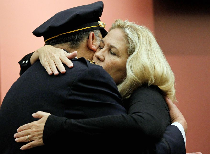 Maureen Faulkner, widow of Philadelphia police Officer Daniel Faulkner, and Philadelphia Police Commissioner Charles H. Ramsey embrace at news conference Wednesday. Faulkner's killer is no longer facing the death penalty. (Associated Press)
