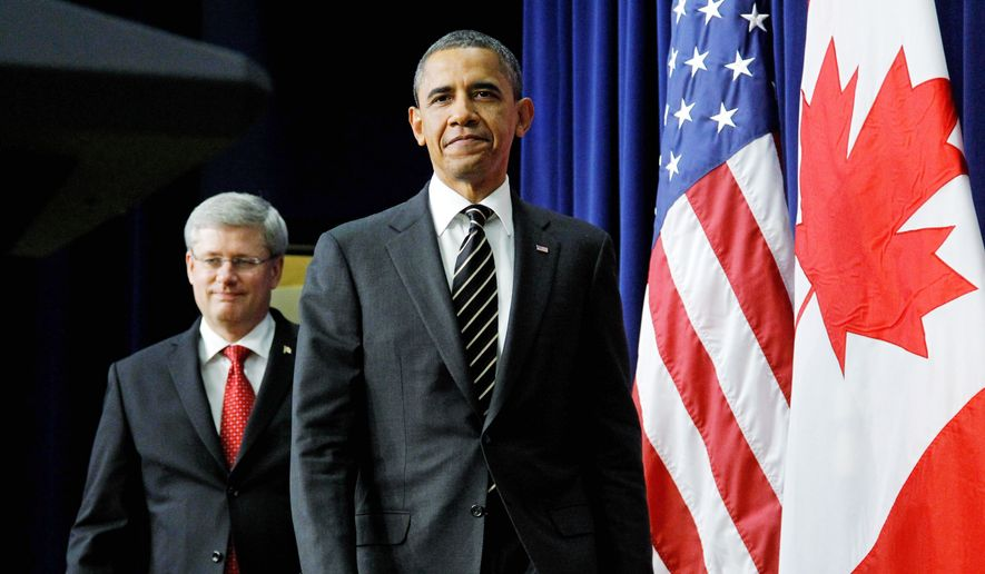 President Obama and Canadian Prime Minister Stephen Harper appeared in front of reporters Dec. 7, 2011, to answer questions after meeting at the White House about border issues, including the Keystone oil pipeline project. (Associated Press) **FILE**