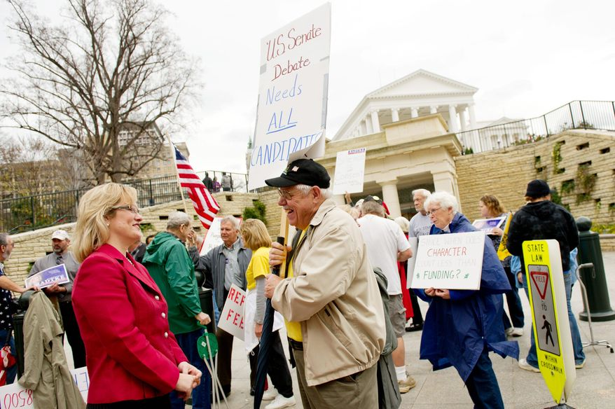 Jamie Radtke, Tea Party candidate for U.S. Senate (left), talks with supporter Tommy Moser (center) of Rockingham County, Va., at a protest outside a debate between Tim Kaine and George Allen. Third-party candidates were excluded from participating in the debate in Richmond on Wednesday. (Andrew Harnik/The Washington Times)