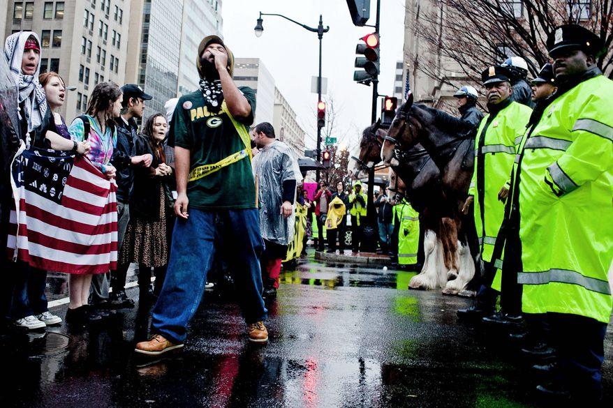 Occupy D.C. protesters stand off with police as they block 14th and K streets NW in Washington on Wednesday, Dec. 7, 2011. (T.J. Kirkpatrick/The Washington Times)