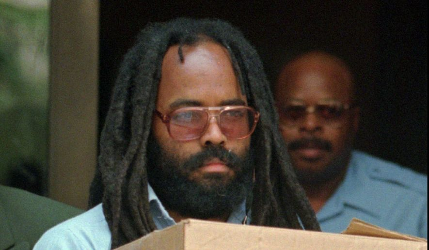 In this July 12, 1995, file photo, Mumia Abu-Jamal leaves Philadelphia's City Hall after a hearing. District Attorney Seth Williams announced Wednesday, Dec. 7, 2011, that prosecutors will no longer pursue the death penalty against the former Black Panther, meaning he will spend the rest of his life in prison for gunning down a white police officer nearly 30 years ago. (AP Photo/Chris Gardner, File) ** FILE **