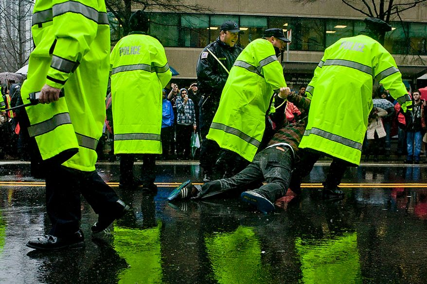 Occupy DC protestors are arrested as they block the intersection of 14th St. NW and K St. NW in Washington, D.C. on Dec. 7, 2011. (T.J. Kirkpatrick/ The Washington Times)