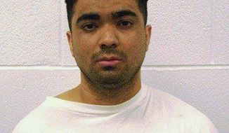 Erickson Dimas-Martinez was convicted of murder in 2010. The Arkansas Supreme Court on Thursday tossed out the conviction, finding misconduct among jurors who slept and tweeted during the court proceedings. (Associated Press)