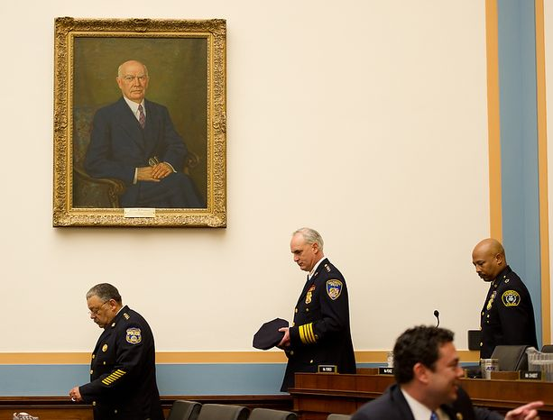 """Philadelphia Police Department Police Commissioner Charles Ramsey, left, Baltimore Police Department Commissioner Frederick H. Bealefeld III, center, and Detroit Police Chief Ralph Godbee, right, enter the House Judiciary Committee room to show support for U.S. Attorney General Eric Holder as he testifies about """"Fast and Furious"""" a federal gun sting which allowed weapons to go to Mexican drug cartels through straw buyers, Thursday, December 8, 2011. (Andrew Harnik / The Washington Times)"""