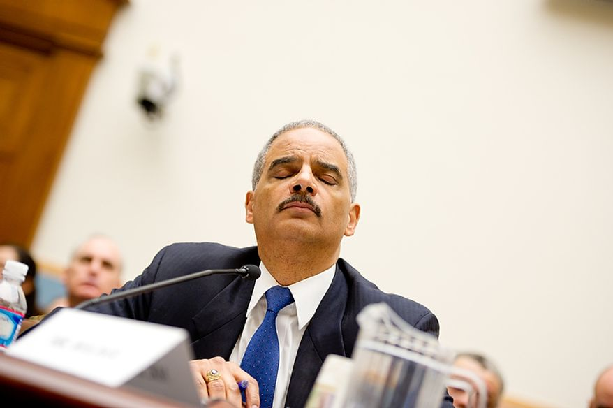 "U.S. Attorney General Eric Holder shows his frustration while giving testimony before the House Judiciary Committee concerning ""Fast and Furious"" a federal gun sting which allowed weapons to go to Mexican drug cartels through straw buyers, Thursday, December 8, 2011. (Andrew Harnik / The Washington Times)"