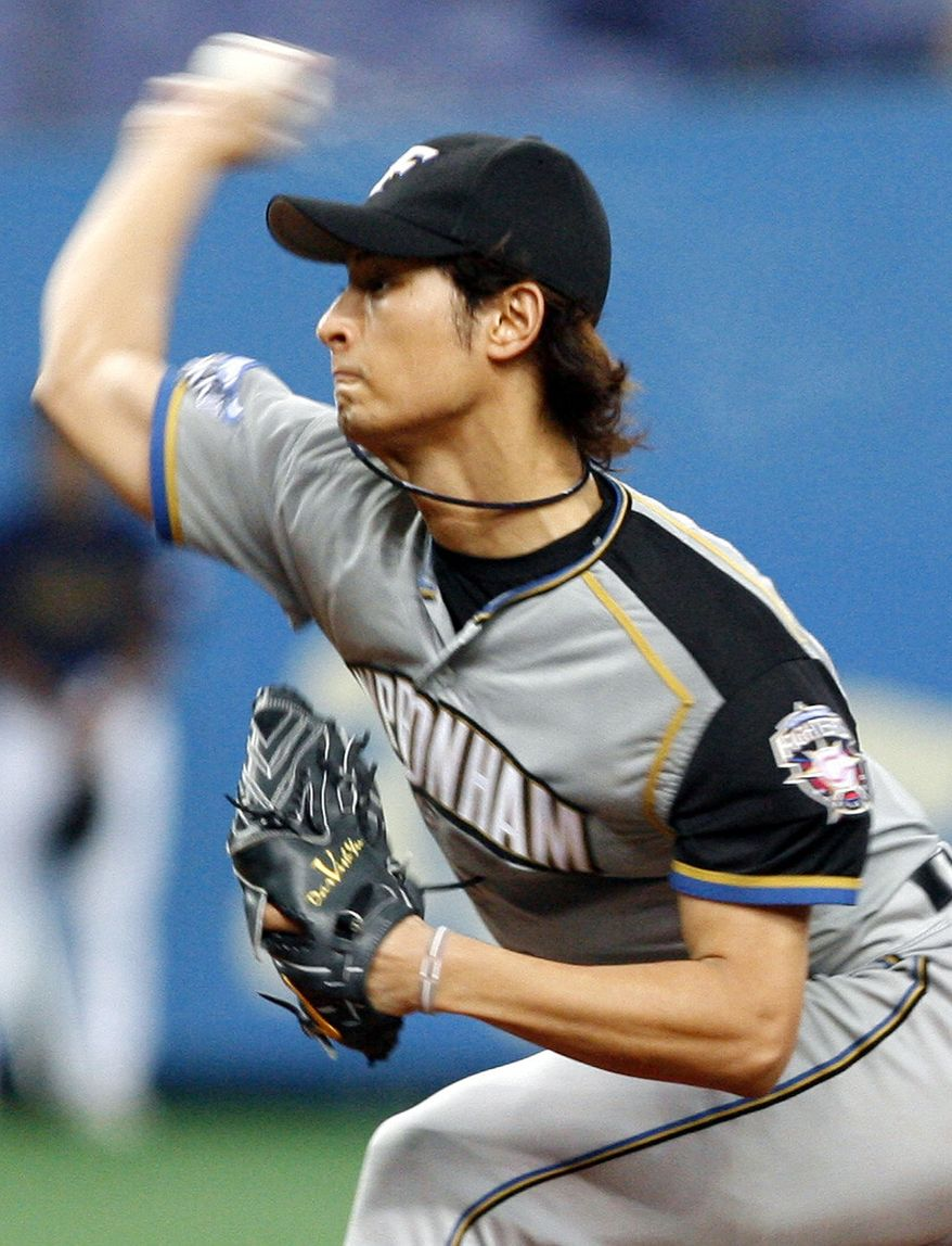 ** FILE ** In this Sept. 5, 2007, file photo, Nippon Ham Fighters starter Yu Darvish pitches against the Orix Buffaloes in Osaka, western Japan. (AP Photo/Kyodo News, File)