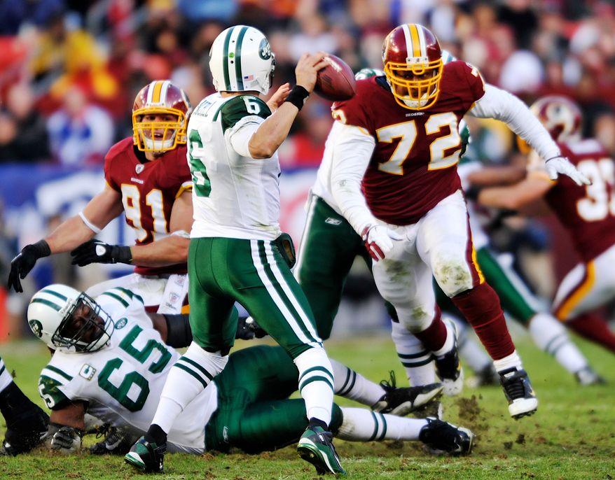 Washington Redskins linebacker Ryan Kerrigan and defensive lineman Stephen Bowen bear down on New York Jets quarterback Mark Sanchez as he drops back to pass Sunday, Dec. 4, 2011, in Landover, Md. The Jets won 34-19. (AP Photo/The Free Lance-Star, Dave Ellis)