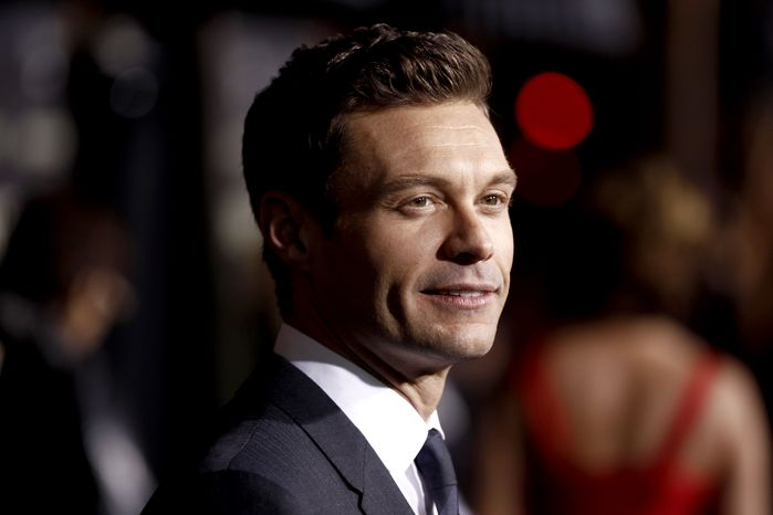 """Ryan Seacrest arrives at the premiere of """"New Year's Eve"""" in Los Angeles on Monday, Dec. 5, 2011. (AP Photo/Matt Sayles)"""