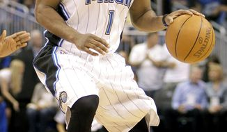 FILE - In this April 16, 2011, file photo, Orlando Magic's Gilbert Arenas moves the ball against the Atlanta Hawks during the second half of Game 1 of a first-round NBA playoff basketball series in Orlando, Fla. The Orlando Magic waived Arenas on Friday, Dec. 9, not long after teams could begin making personnel moves after the lockout's formal end. Arenas was owed three years and just over $62 million. He'll still get that money, but it won't count against the Magic for salary cap and luxury-tax purposes, per the league's new amnesty clause. (AP Photo/John Raoux, File)
