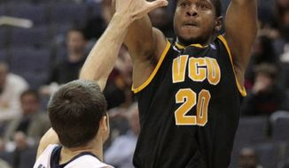 Virginia Commonwealth's Bradford Burgess, shown in a game against George Washington, had 14 points, nine rebounds, three assists and three steals in VCU's win over Richmond on Friday.  (AP Photo/Luis M. Alvarez)