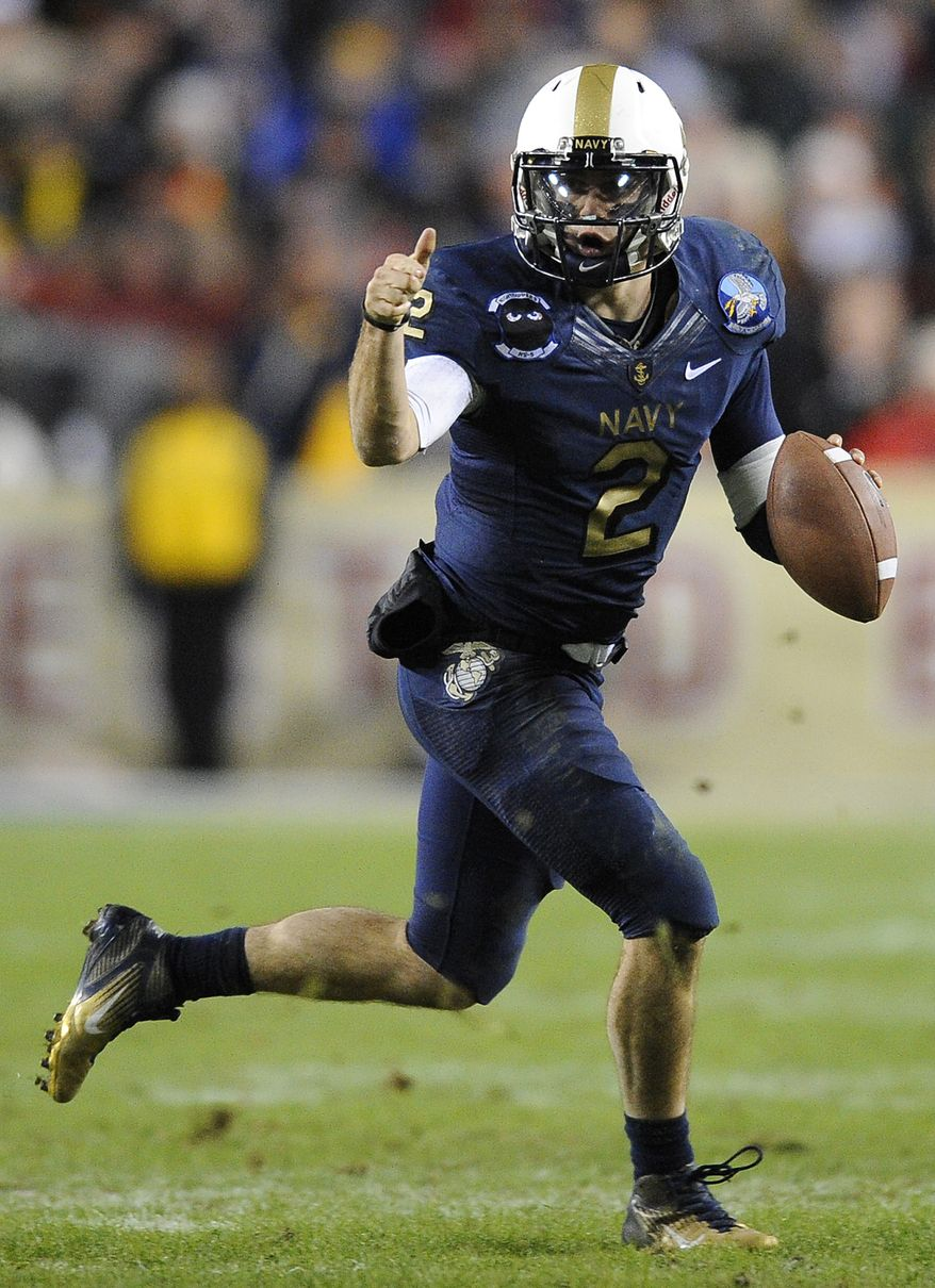 Navy quarterback Kriss Proctor rushes the ball in the second half of an NCAA college football game against Army in Landover, Md., Saturday, Dec. 10, 2011. Navy won 27-21. (AP Photo/Nick Wass)