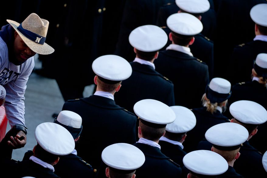 A fan welcomes Navy Midshipmen as they march into the stadium before the Army-Navy game at Fedex Field, Landover, MD, Saturday, December 10, 2011. (Andrew Harnik / The Washington Times)
