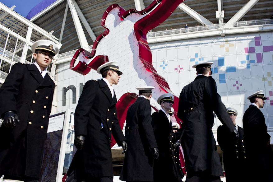 Navy midshipmen line up to enter FedEx Field for the Army-Navy game, in Landover, Md. on Dec. 10, 2011. Navy beat Army 27-21 for it's 10th win in a row. (T.J. Kirkpatrick/ The Washington Times)