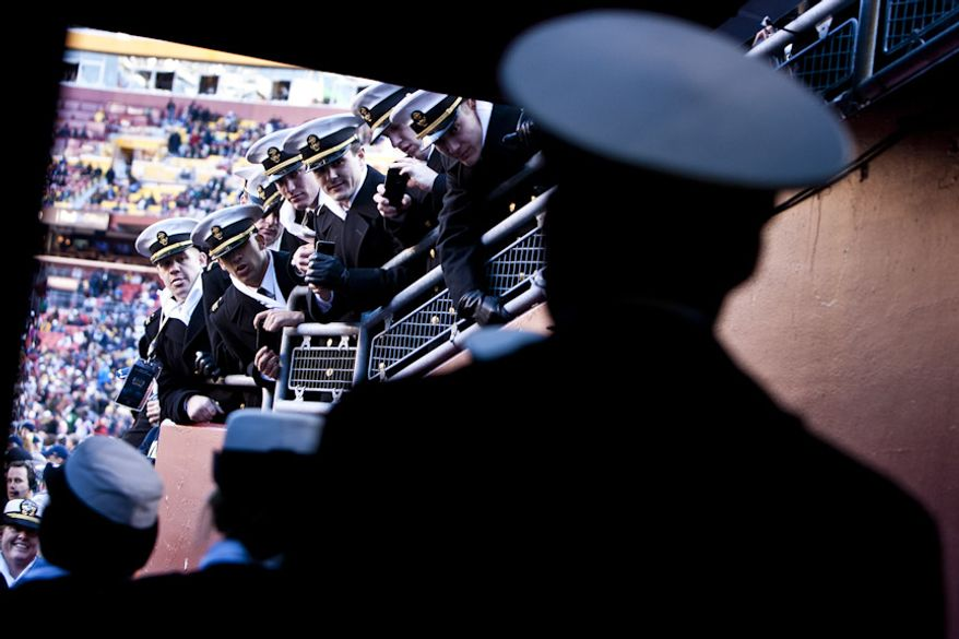 Navy midshipmen wait to enter FedEx Field before the Army-Navy game, in Landover, Md. on Dec. 10, 2011. Navy beat Army 27-21 for it's 10th win in a row. (T.J. Kirkpatrick/ The Washington Times)