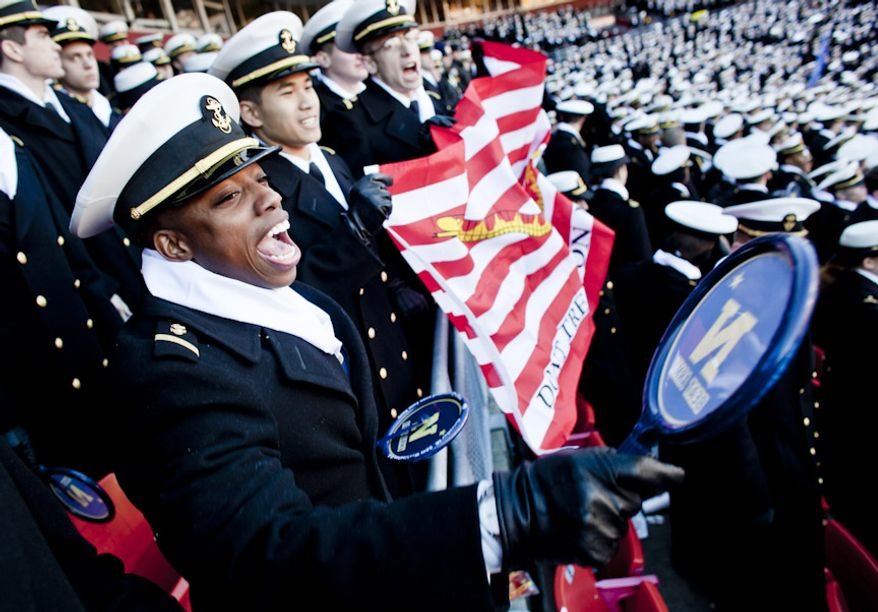 Navy Midshipmen 2nd Class Tyshan Larry, from left, Duc Nguyen and Kyle Bunker cheer during the first half of the Army-Navy game at FedEx Field in Landover, Md. on Dec. 10, 2011. Navy beat Army 27-21 for it's 10th win in a row. (T.J. Kirkpatrick/ The Washington Times)