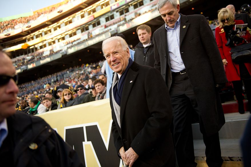 Vice President Joe Biden comes down to the field before half time of the Army-Navy game at Fedex Field, Landover, MD, Saturday, December 10, 2011. (Andrew Harnik / The Washington Times)