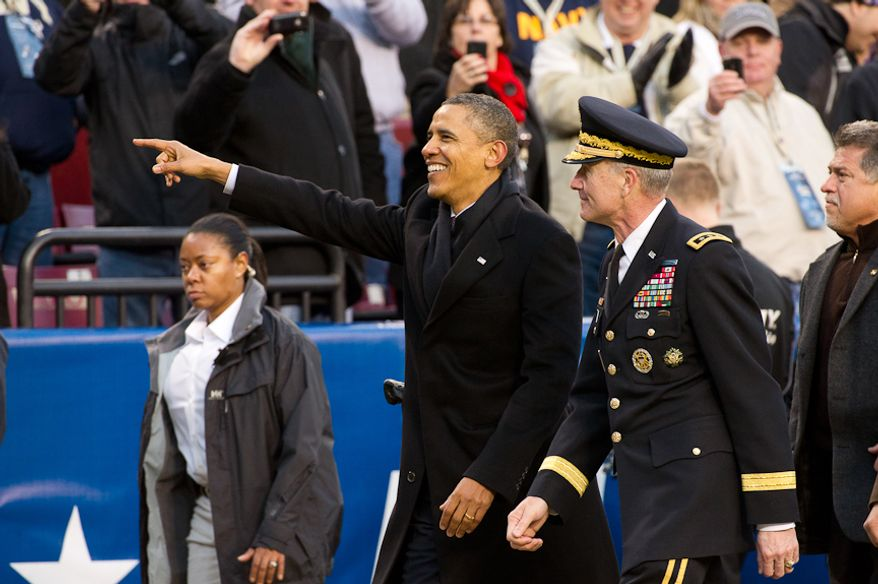 President Barak Obama changes to the Army side of the field during halftime of the Army-Navy game at Fedex Field, Landover, MD, Saturday, December 10, 2011. (Andrew Harnik / The Washington Times)