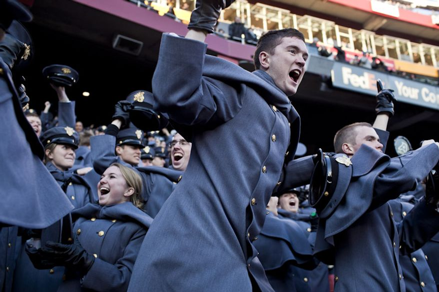 Aaron Kilner, a 4th Class Army Cadet, at center, celebrates with his fellow Company C-3 cadets after Army ties the score at 14-14 during the first half of the Army-Navy game at FedEx Field in Landover, Md. on Dec. 10, 2011. Navy has won the last nine times and the Army cadets were excited about a tie game entering half time. (T.J. Kirkpatrick/ The Washington Times)