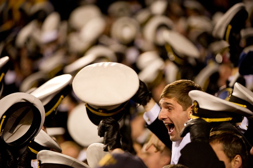 Navy Midshipmen celebrate as Navy wins 27-21 over Navy at Fedex Field, Landover, MD, Saturday, December 10, 2011. (Andrew Harnik / The Washington Times)