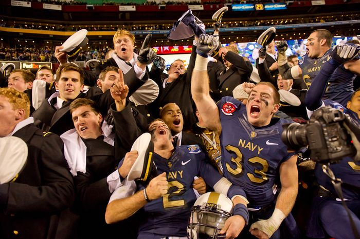 Navy Midshipmen quarterback Kriss Proctor (2) and Navy Midshipmen running back John Howell (33) cheer with fellow Midshipmen in the stands after defeating the Army Black Nights 27-21 at FedEx Field, Landover, Md., Saturday, Dec. 10, 2011. (Andrew Harnik / The Washington Times)