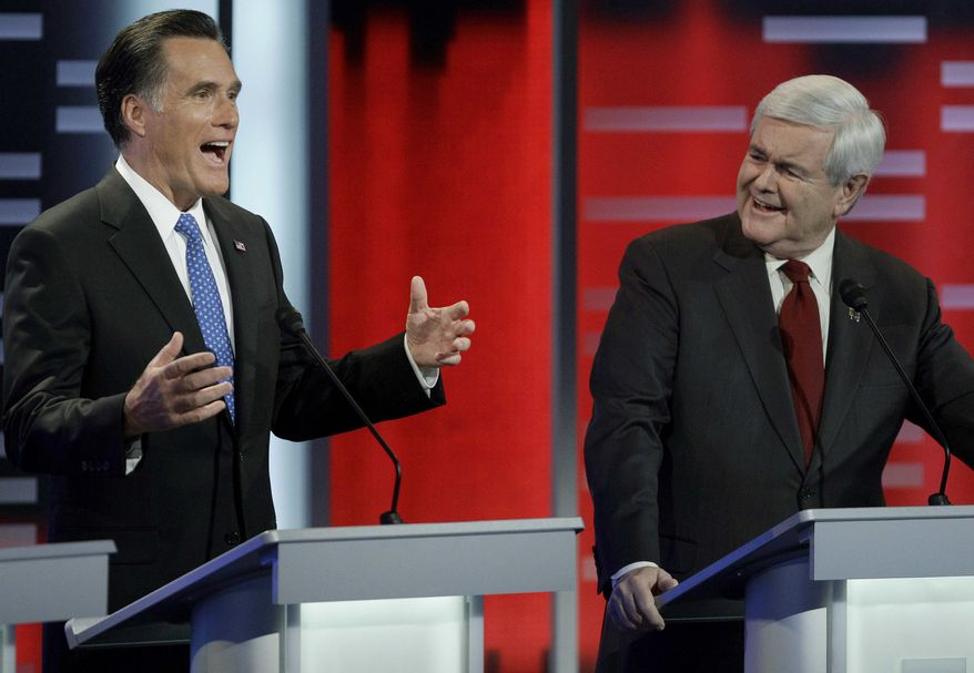 Republican presidential candidates former Massachusetts Gov. Mitt Romney, left, and former Speaker of the House Newt Gingrich, right, take part in the Republican debate, Saturday, Dec. 10, 2011, in Des Moines, Iowa. (AP Photo/Charlie Neibergall)