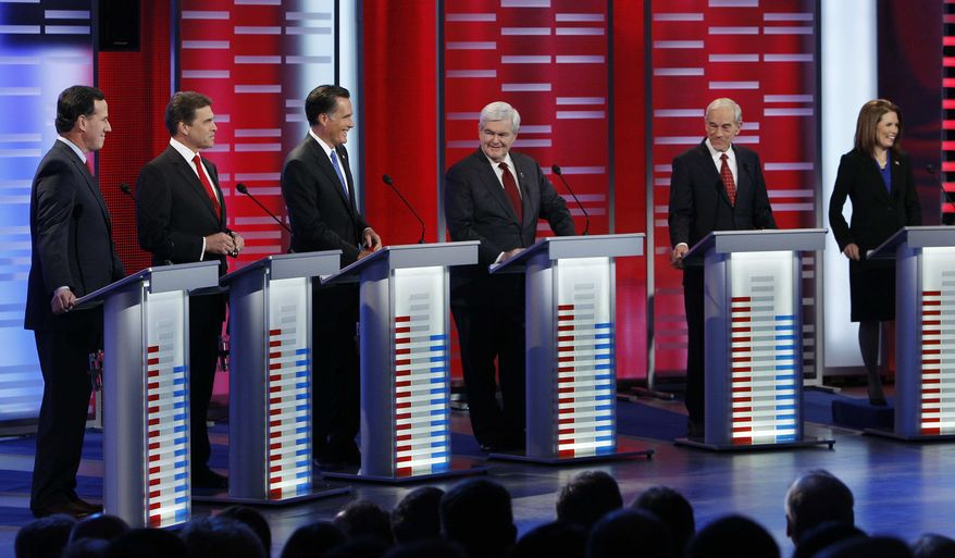 Republican presidential candidates, from left, former Pennsylvania Sen. Rick Santorum, Texas Gov. Rick Perry, former Massachusetts Gov. Mitt Romney, former Speaker of the House Newt Gingrich, Rep. Ron Paul, R-Texas, and Rep. Michele Bachmann, R-Minn, take their place for a Republican debate, Saturday, Dec. 10, 2011, in Des Moines, Iowa. (AP Photo/Eric Gay)