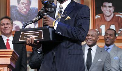 In this photo provided by the Heisman Trophy Trust, Robert Griffin III, of Baylor University, holds the Heisman Trophy award after being named the winner, Saturday, Dec. 10, 2011, in New York. (AP Photo/Heisman Trophy Trust, Kelly Kline)