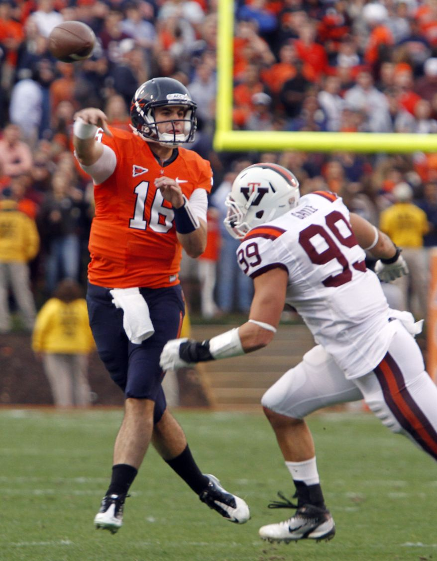 Virginia quarterback Michael Rocco makes a pass as Virginia Tech defensive end James Gayle closes in during the first half at Scott Stadium in Charlottesville, Va., Saturday, Nov. 26, 2011. (AP Photo/Steve Helber)