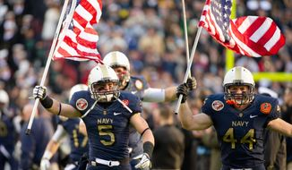 Navy's exuberance was evident before kickoff, as the Mids followed the flag onto the field. (Andrew Harnik / The Washington Times)