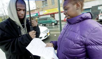 Shaquoia Waring and Daniel Jefferson look at their letter of rejection outside a homeless center in New York. Ms. Waring said she tried unsuccessfully to convince officials that her family couldn't return to her grandmother's apartment in public housing, where two bedrooms have been housing nine people. (Associated Press)