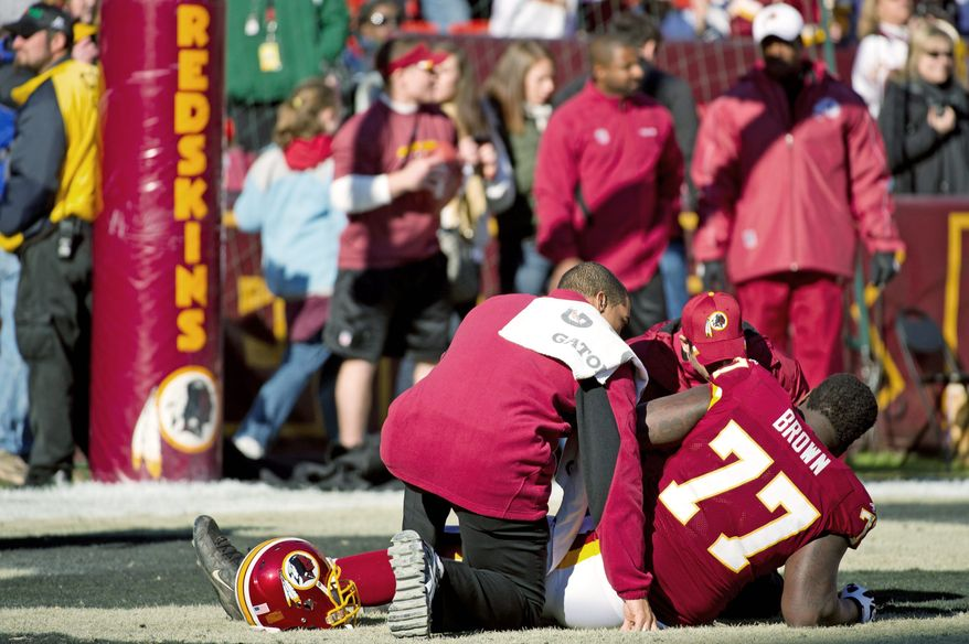 Redskins tackle Jammal Brown (77) re-aggravated a groin injury during warmups, necessitating another offensive line combination. (Andrew Harnik/The Washington Times)