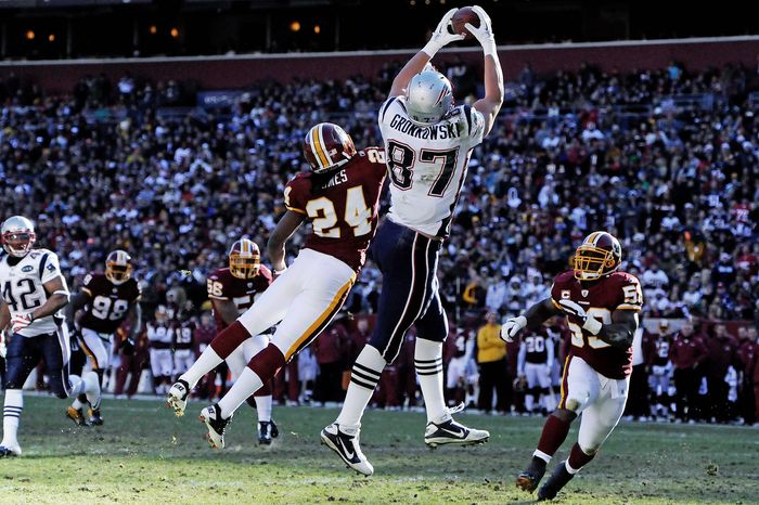 Patriots tight end Rob Gronkowski hauls in a first-quarter touchdown pass, his first of two scores, as the Redskins' DeJon Gomes defends. Gronkowski had six catches for 160 yards. (Preston Keres/Special to The Washington Times)
