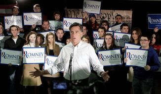 ON THE STUMP: Mitt Romney talks to reporters after the We the People Presidential Forum at a VFW Post in Hudson, N.H., on Sunday. The rise of challenger Newt Gingrich has stirred up the Romney super PAC, Restore Our Future. (Associated Press)