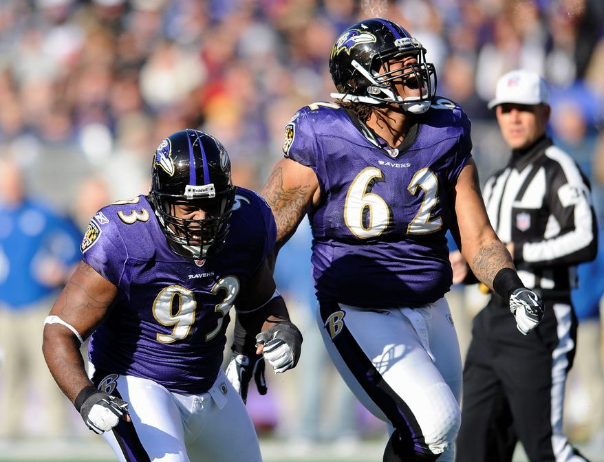 Baltimore defensive end Cory Redding (left) and nose tackle Terrence Cody react after making a tackle at the line of scrimmage during the first half. The Ravens held Indianapolis to 167 yards in their 24-10 win. (Associated Press)