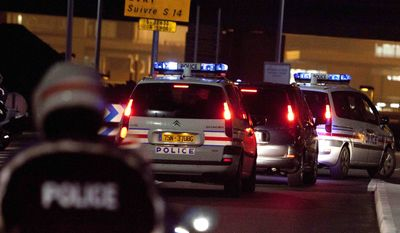 A police car (second from right) believed to be carrying former Panamanian military strongman Manuel Noriega arrives at Orly Airport, south of Paris, after leaving La Sante Prison on Sunday, Dec. 11, 2011. (AP Photo/Thibault Camus)