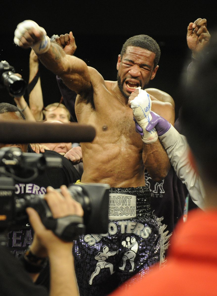 Lamont Peterson celebrates his win over Amir Khan in a boxing match, Sunday, Dec. 11, 2011, in Washington. (AP Photo/Nick Wass)