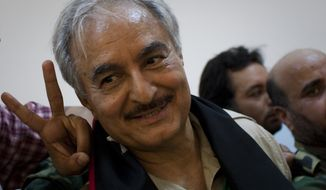 ** FILE ** Khalifa Hifter, then the Libyan senior rebel commander, leaves a press conference at the courthouse in the center of Benghazi, Libya, in March 2011. (AP Photo/Anja Niedringhaus, File)