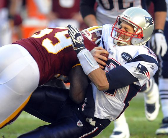 New England Patriots quarterback Tom Brady is hit by Washington Redskins inside linebacker London Fletcher during the first half on Sunday, Dec., 11, 2011, in Landover, Md. (AP Photo/Rich Lipski)