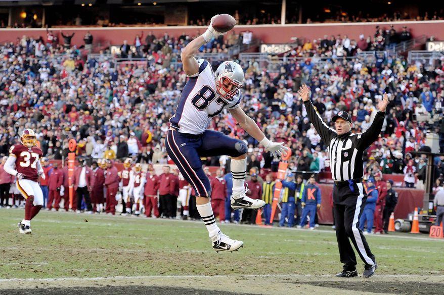 New England Patriots tight end Rob Gronkowski celebrates his third-quarter touchdown at FedEx Field in Landover, Md., on Sunday, Dec. 11, 2011. (Preston Keres/Special to The Washington Times)