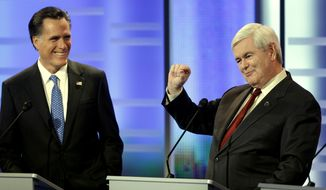 Former Massachusetts Gov. Mitt Romney (left) and former Speaker of the House Newt Gingrich take part in the Republican presidential debate on Saturday, Dec. 10, 2011, in Des Moines, Iowa. (AP Photo/Charlie Neibergall)